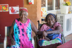 Two ladies holding hands at a NWRH Aged Care Facility